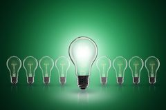 Idea concept - light bulb on the color background. Idea and leadership concept - incandescent light bulb on the color background stock photo