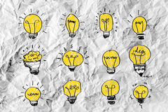 Idea concept light bulb on crumpled paper Royalty Free Stock Photo