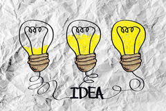 Idea concept light bulb on crumpled paper Stock Photography