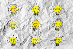 Idea concept light bulb on crumpled paper Stock Images