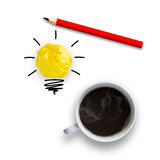 Idea concept with light bulb pencil and a cup of coffee Stock Photos