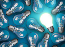 Idea concept. With light bulbs on blue background Royalty Free Stock Photos