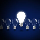 Idea  concept  with  light bulbs on a blue background Royalty Free Stock Photography