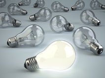 Idea concept. Light bulbs on grey background. Royalty Free Stock Photo