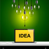 Idea concept. Light bulbs and laptop background Stock Photography