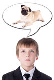 Idea concept - little boy in business suit thinking about dog is. Olated on white background Stock Image