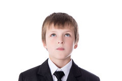 Idea concept - little boy in business suit thinking about someth Royalty Free Stock Photo