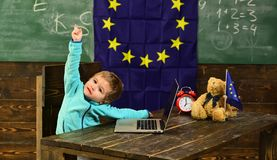 Idea concept. Little child got creative idea in classroom with eu flag. Genius child create idea with innovative. Technology. Idea and creativity. For the royalty free stock images