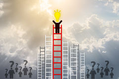 Idea concept. man have idea standing on top of ladder Royalty Free Stock Images