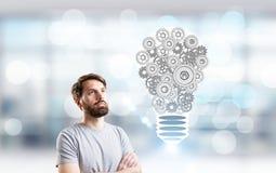 Idea concept metallic gear bulb Stock Image