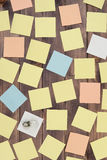Idea, concept, notion, thought. Multicolored stickers are on a wooden table. View from above Stock Images