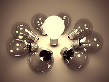 Idea Concept Of One Glowing Light Bulb In The Dark Stock Photo
