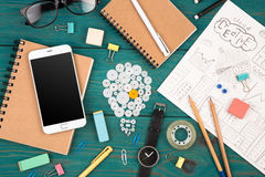 Idea concept - phone, watch, notepads, pencils and office suppli Royalty Free Stock Photos