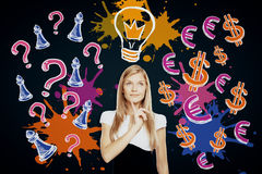 Idea concept. Thoughtful young businesswoman on dark background with drawn light bulb, question marks and chess figures. Idea concept Royalty Free Stock Image