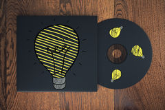Idea concept. Top view of wooden desktop with creative light bulb drawn on CD cover. Idea concept. 3D Rendering royalty free stock photos
