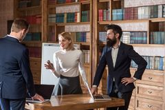 Idea concept. University students discuss new ideas in library. Businessmen and woman exchange business ideas. Focus on. Idea concept. University students stock photo