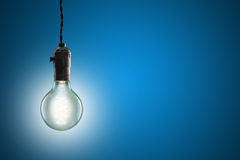 Idea concept - Vintage incandescent bulb on blue background Stock Photography