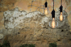 Idea concept - Vintage incandescent bulb on wall background, cop Stock Photo