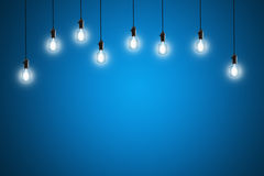Idea concept - Vintage incandescent bulbs on blue background Stock Photography