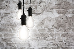 Idea concept - Vintage incandescent bulbs on wall background Stock Photography
