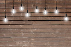 Idea concept - Vintage incandescent bulbs on wooden wall Stock Image