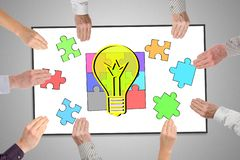 Idea concept on a whiteboard. Held by hands royalty free stock image