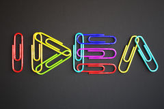 Idea concept. Word 'idea' made of colorful paper clips on dark background. 3D Rendering Stock Photography