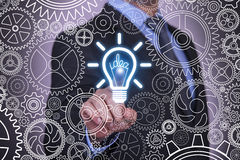Idea Concepts Light Bulb and Gears on Touch Screen Royalty Free Stock Photography