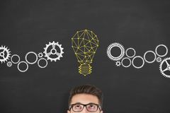 Idea concepts with light bulbs on a chalkboard background. Working royalty free stock photo