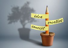 Idea creative concept, pencil with stickers as tree in pot Royalty Free Stock Images