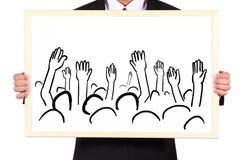 Idea di manifestazione dell'uomo d'affari sul whiteboard Immagine Stock