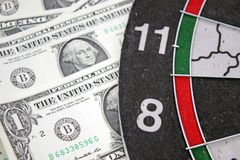 Idea of financial success - darts and dollar Royalty Free Stock Photo