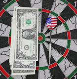Idea of financial success - darts and dollar Royalty Free Stock Photos