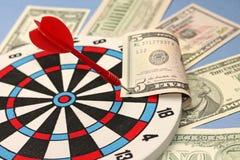 Idea of financial success - darts and dollars Royalty Free Stock Photos