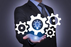 Idea And Gear on Businessman Hand Royalty Free Stock Photo