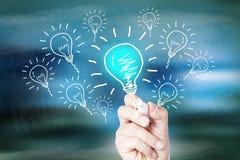 Idea. Hand drawing idea light bulb on screen Royalty Free Stock Image