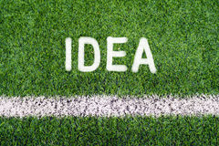 IDEA hand writing text on soccer field grass Stock Images
