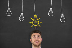 Idea Hanging Light Bulb Concept Drawing on Blackboard Stock Photo