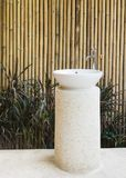 Idea of home decoration outdoor ceramic basin and faucet on bamb Stock Images