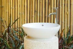 Idea of home decoration outdoor ceramic basin and faucet on bamb Stock Photography