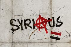 Idea for the humanitarian crisis in Syria. Graffiti of the words SYRIA and SERIOUS combined on a cracked wall Stock Image