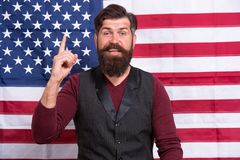 Idea and ideology. Patriotic concept. American lawyer teacher speaker or tv host american flag background. Love homeland. Man with beard and mustache with royalty free stock image