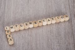 Idea implementation blocks on table. Idea Implementation wooden blocks arranged on table Stock Images