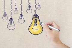 Idea, innovation and brainstorm concept. Hand drawing creative lamp sketch on concrete wall background. Idea, innovation and brainstorm concept Royalty Free Stock Image