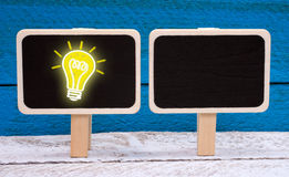 Idea and Innovation - chalkboard with light bulb Royalty Free Stock Image