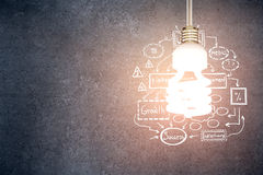 Idea and innovation concept. Lamp on concrete wall background with business sketch. Idea and innovation concept. 3D Rendering Stock Photos