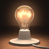 Idea. Lamp lit with the filament-shaped of the idea word Stock Photos