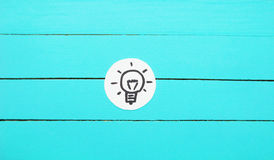 Idea. Lamp on wood Background. Place for text.Idea Stock Photos
