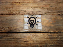 Idea. Lamp on wood Background. Place for text.Idea Stock Images
