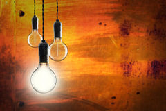Idea and leadership concept -  bulbs on the grunge background Stock Images